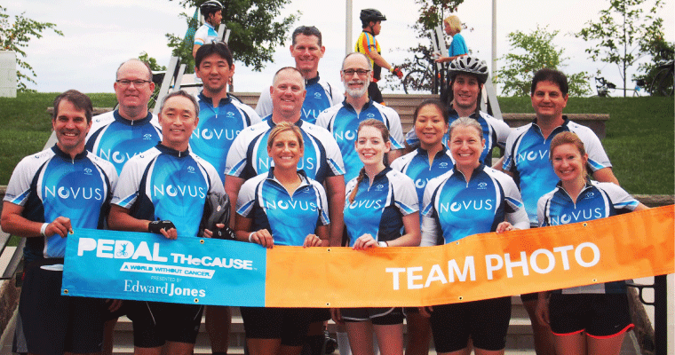 Novus International employees cycle team